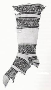 The oldest real knitting (formed on two sticks by pulling loops through loops) we've got is 'Coptic socks' from Egypt, from around the year 1000 CE